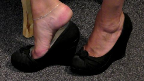 Amateur chick with sensitive feet feels very comfortable wearing black shoes with pupms