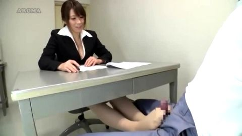 Busty Japanese female lawyer gives an inmate an intense footjob in the prison