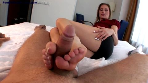 Woman in super sexy short skirt is on her side delivering the most amazing footjob aver