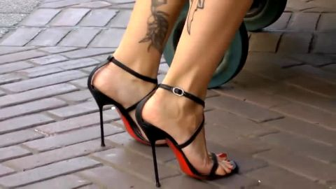 Short haired German wearing sexy summer dress and high heel shoes on her pretty feet