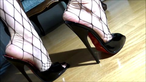 Mature lady in fishnet getting in her brand new nigh heel shoes