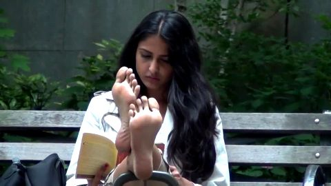 Horny voyeur gets turned on by watching beautiful brunette with candid feet in public