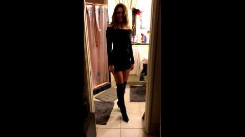 Hot mature lady looks so good in her tight black dress and sexy boots