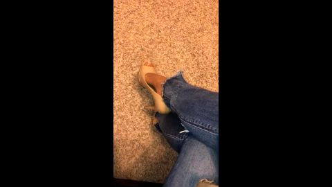 Sophisticated amateur woman wearing sexy jeans and high heel shoes