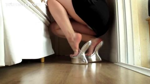 Sexy lady tries out her brand new silver shoes in homemade foot fetish scene