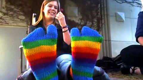 Lovely amateur girl shows off her colorful socks and feet in public