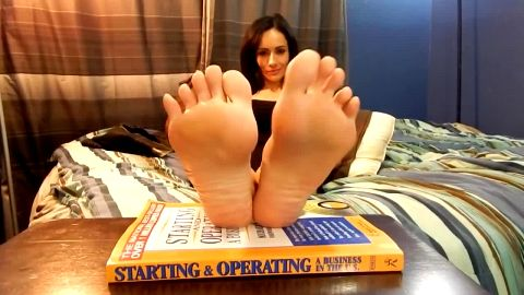 Lusty brunette showing her beautiful soles and feet during her solo fetish session