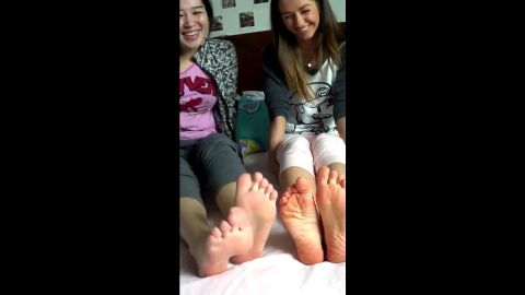 Lovely teenage babes wiggling their delicious feet and toes in bed