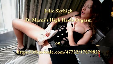 Naughty Julie Skyhigh fucks herself with a high heel while sitting in the chair
