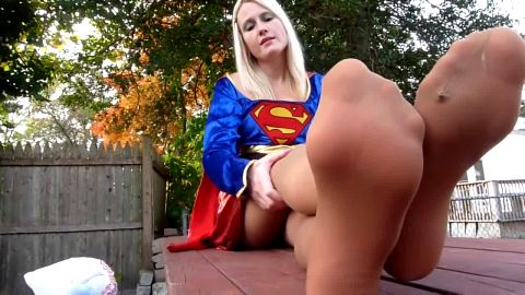 Blonde exposes her hot legs and feet outdoors in sexy costume and stockings