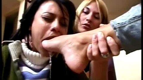 Two dominant girlfriends in a hot foot fetish threesome with their female slave