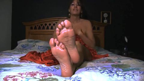 Naked wife showing her sexy mature oily feet while rubbing her nipples