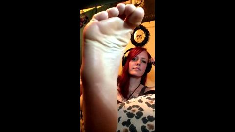 Cute amateur redhead massaging her lovely feet and toes on her cam