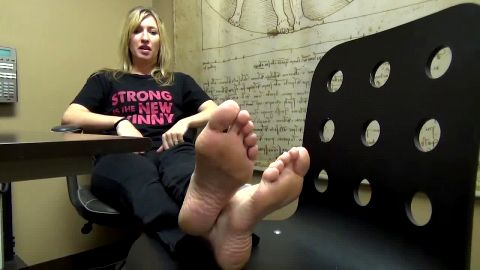 Delicious blonde gets rid of her nasty socks and shows the world her amazing mature feet