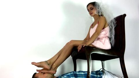 Little mistress resting her wonderful feet on her male slave's face