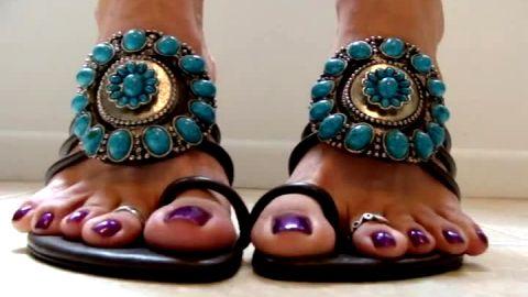 close up purple big toes nails