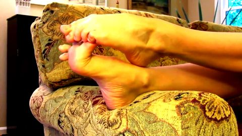 Lonely amateur housewife in on the sofa playing with her sexy naked feet
