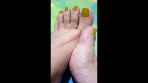 Filmed my mature amateur feet and toes with yellow nail polish close up