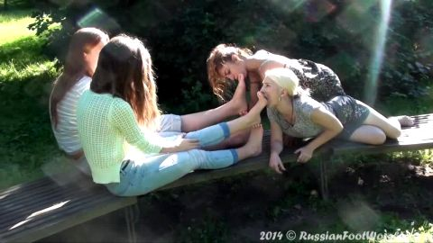Four beautiful Russian college girls in lesbian outdoor feet licking action