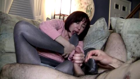 My sexy mature lady takes a huge facial cumshot after delivering an intense footjob
