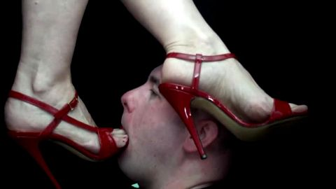 Bald slave gets slapped hard by his mistress's sexy feet with red toe nails