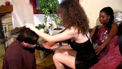 Two bossy French dominas torture and humiliate their submissive foot slave