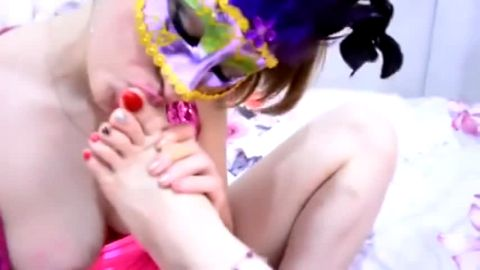 Horny masked lesbians kissing & licking each other's delicious feet in bed