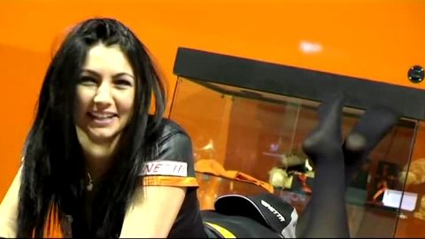 Horny voyeur films attractive dark haired model in sexy stockings at the car show