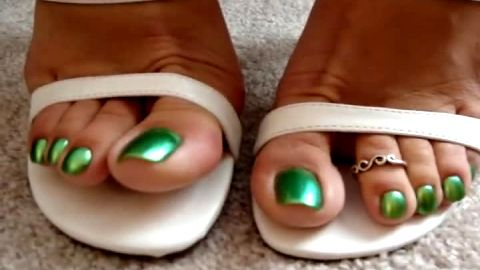 Lusty MILF wiggling her pretty toes with exotic green nail polish