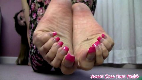 Asian mistress Sweet Coco spreading her sexy toes with pink toe nails