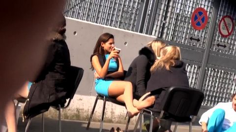 Voyeur catches sexy lady in tight dress and nylon stocking resting her feet in public