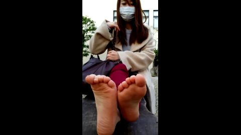 Cute Japanese girl shows her phenomenal Asian feet to me in public