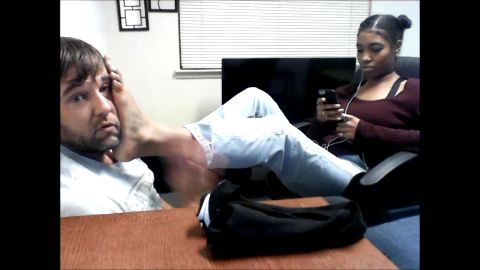Teenage ebony beauty places her sexy black feet on her slave's face