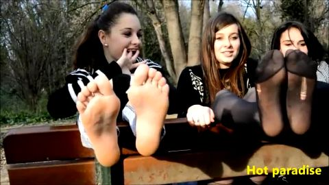 Three kinky college babes revealing their wonderful feet in the park
