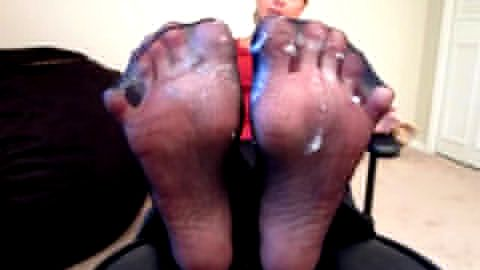 Middle aged woman showing off her phenomenal mature feet in nylon stockings