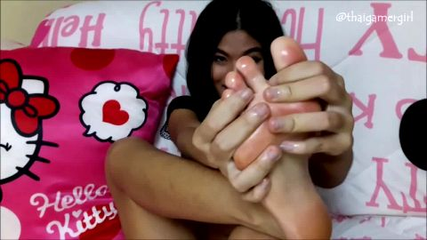 Lovely Thai babe oils up & massages her sexy Asian feet and