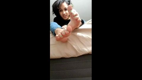 Petite ebony in hot jeans worships her own caramel feet with green nail polish