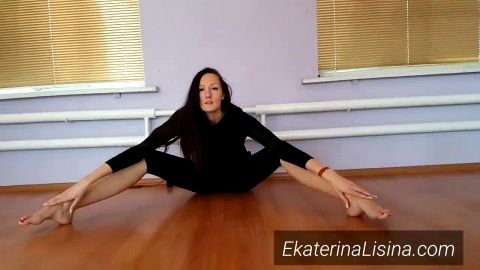 Stunning brunette with lovely feet dancing in sexy black yoga pants