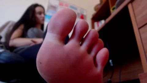 Dark haired amateur babe reveals her sweet feet while working at the computer