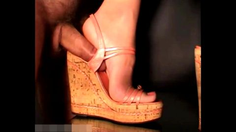 Hottie in high platform sandals gives a great shoejob to a small dick dude