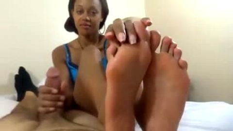 Sweet ebony doll using her spectacular caramel feet on my fat cock