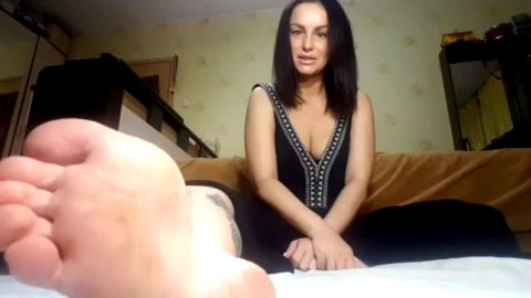 Lusty big tit Russian MILF likes talking dirty in her solo foot fetish session