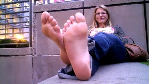 Nerdy blonde office chick flirting barefoot with strangers in public