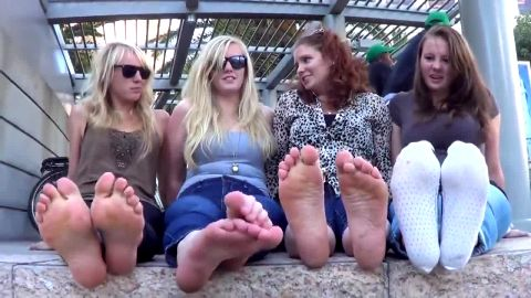 Four amateur girlfriends get rid of their shows and display hot feet down town