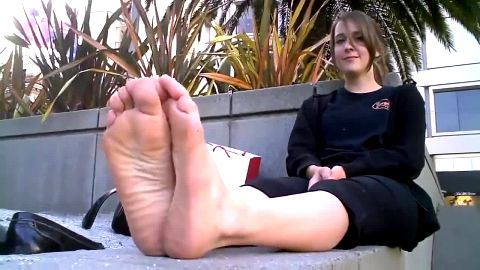Gorgeous girl exposes her smelly feet in public during her lunch break