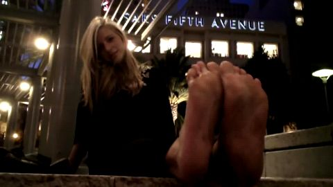 Lusty teenage blonde reveals her dirty amateur feet down town