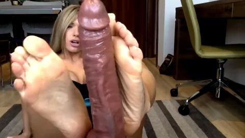 Incredible big tit bombshell giving a giant black plastic cock a superb footjob