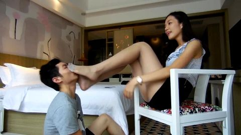 Young Asian guy likes worshipping his sexy mistress's legs and feet
