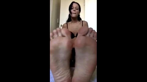 Sexy amateur girl shows her incredible feet while virtually stroking a cock