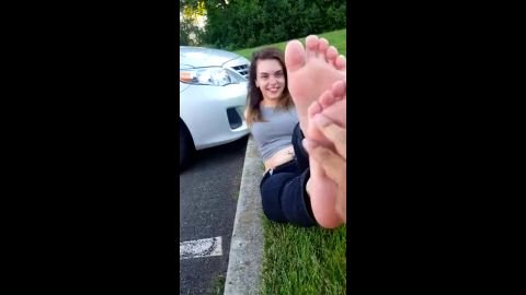 Sweet college brunette gets her magical feet massaged and tickled outdoors